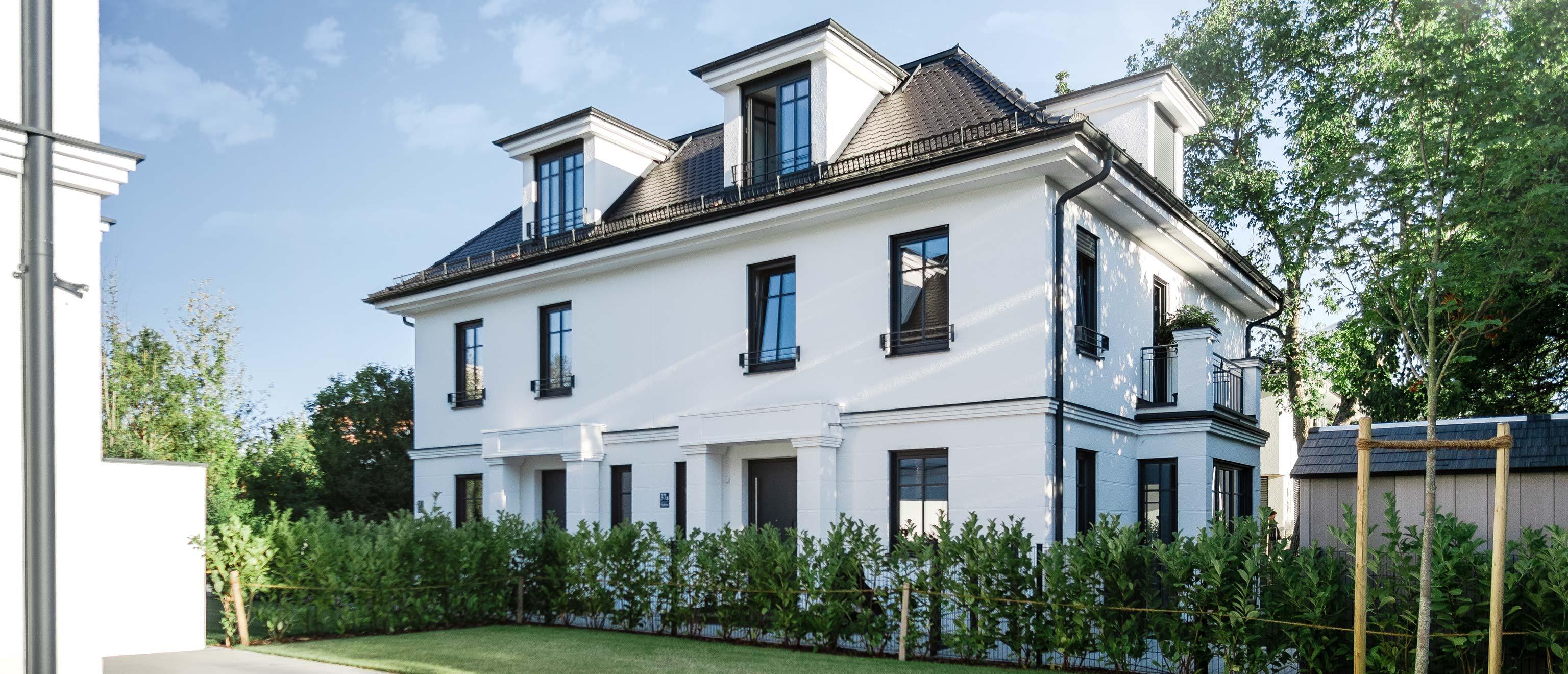 LEAN BAU Referenz | 2 Doppelhäuser mit Duplexgaragen | München